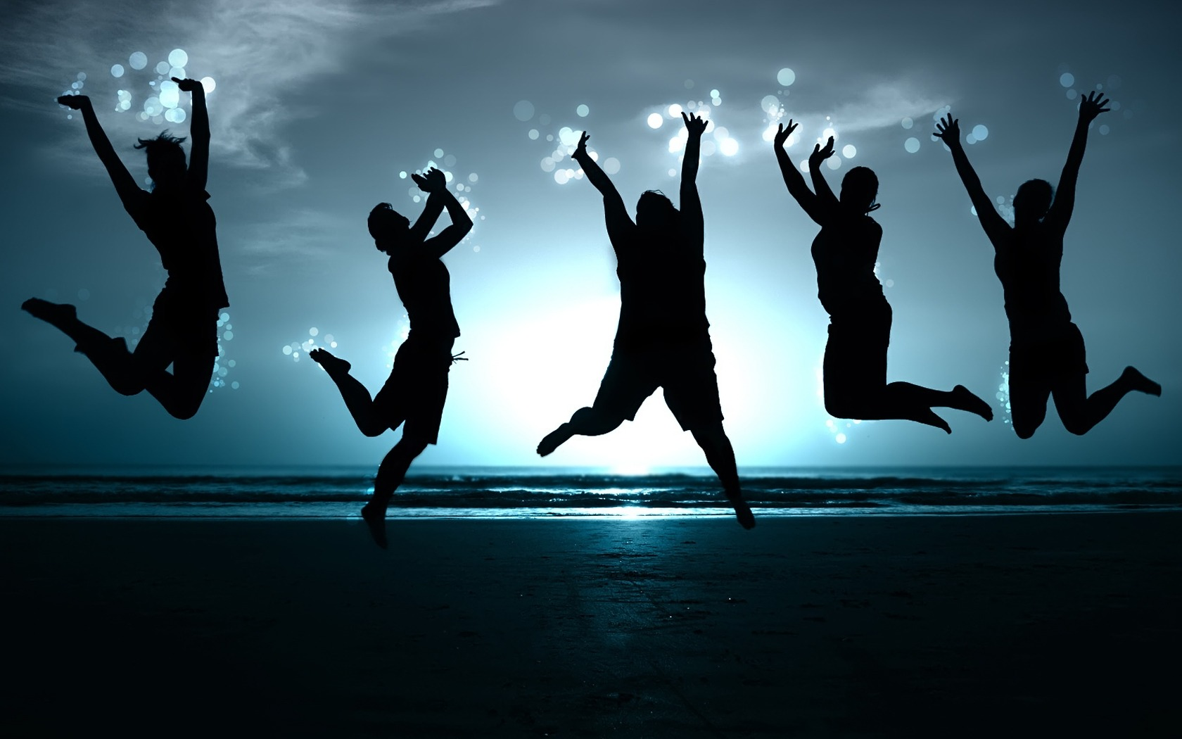 happy-people-jumping-on-beach-sunset
